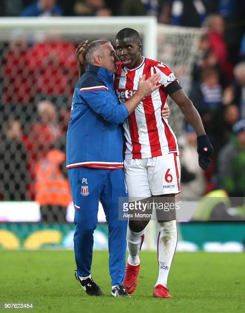 Paul Lambert Manager of Stoke City and Kurt Zouma of Stoke City celebrates victory after the Premier League match between Stoke City and Huddersfield...