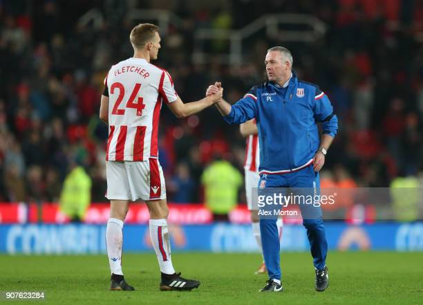 Paul Lambert Manager of Stoke City and Ryan Shawcross of Stoke City celebrates victory after the Premier League match between Stoke City and...