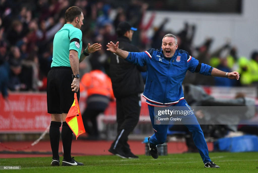 Paul Lambert, Manager of Stoke City celebrates during the Premier League match between Stoke City and Huddersfield Town at Bet365 Stadium on January 20, 2018 in Stoke on Trent, England.