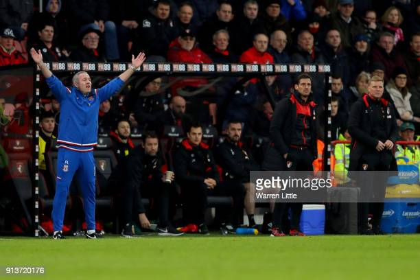 Paul Lambert Manager of Stoke City reacts as Eddie Howe Manager of AFC Bournemouth looks on during the Premier League match between AFC Bournemouth...