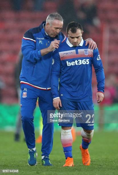 Paul Lambert Manager of Stoke City talks to Xherdan Shaqiri of Stoke City after the Premier League match between Southampton and Stoke City at St...