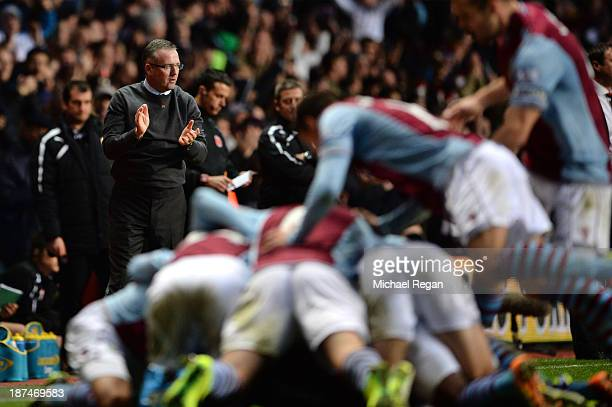 Paul Lambert the Aston Villa manager applauds his players following Leandro Bacuna of Aston Villa opening goal during the Barclays Premier League...