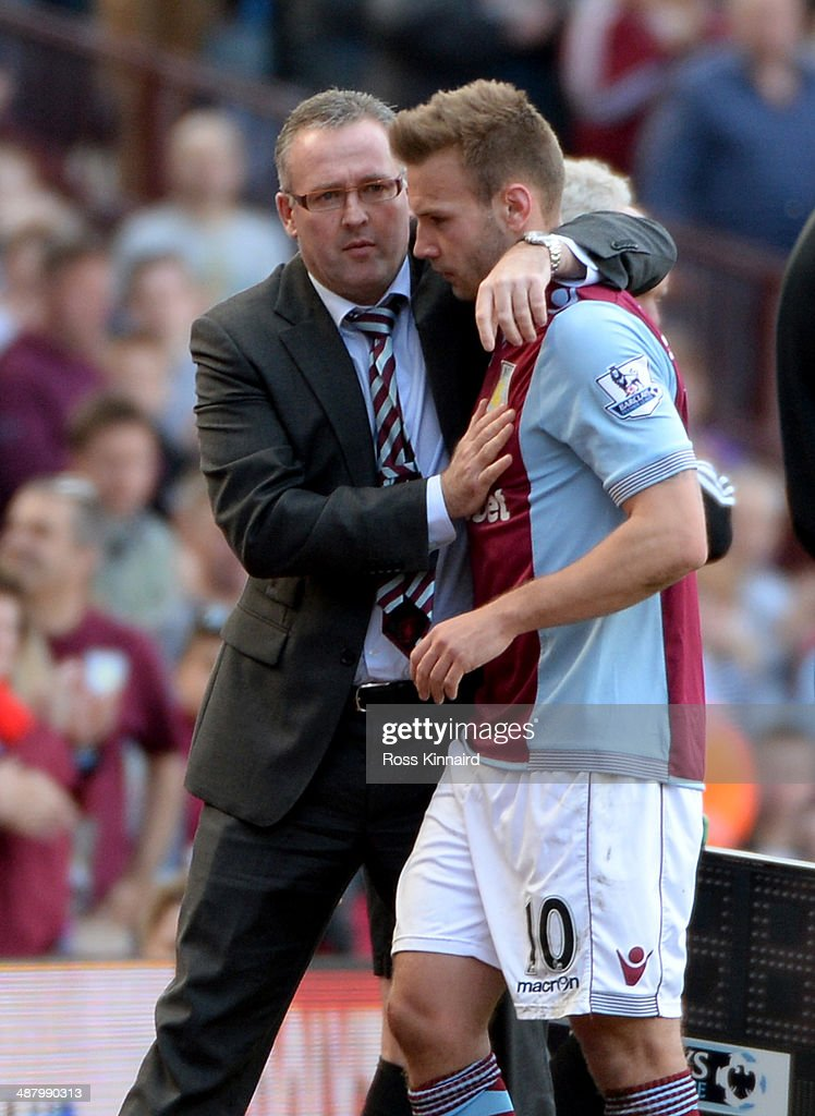Paul Lambert the manager of Ason Villa congratulates Andreas Weimann of Aston Villa during the Barclays Premier League match between Aston Villa and Hull City at Villa Park on May 3, 2014 in Birmingham, England.