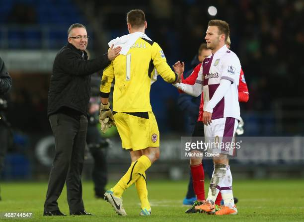 Paul Lambert the manager of Aston Villa pats David Marshall the goalkeeper of Cardiff City on the back after a superb last minute save from Andreas...
