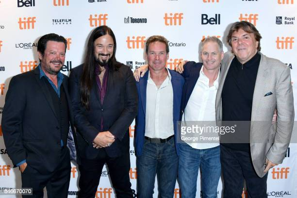 Paul Langlois Rob Baker Gord Sinclair and Johnny Fay of The Tragically Hip and President of Bell Media Randy Lennox attend the 'Long Time Running'...