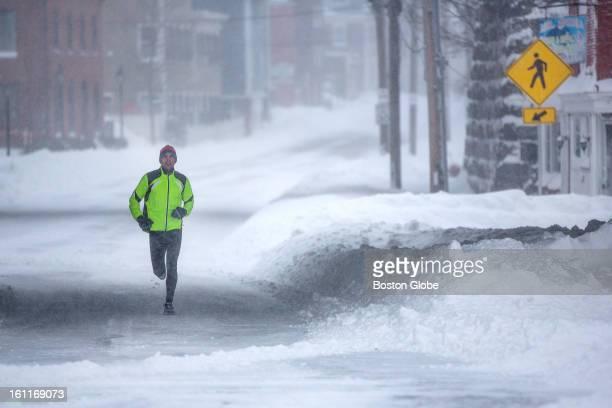 Paul LaRosa of Newburyport went for a run along Merrimac Street in Newburyport as a large winter storm hit the region