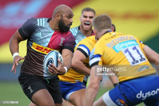 Paul Lasike of Harlequins takes on Ruaridh McConnochie of Bath Rugby during the Gallagher Premiership Rugby match between Harlequins and Bath Rugby...