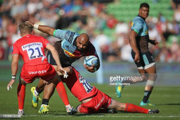 Paul Lasike of Harlequins takes on the Sale Sharks defence during the Gallagher Premiership Rugby match between Harlequins and Sale Sharks at...
