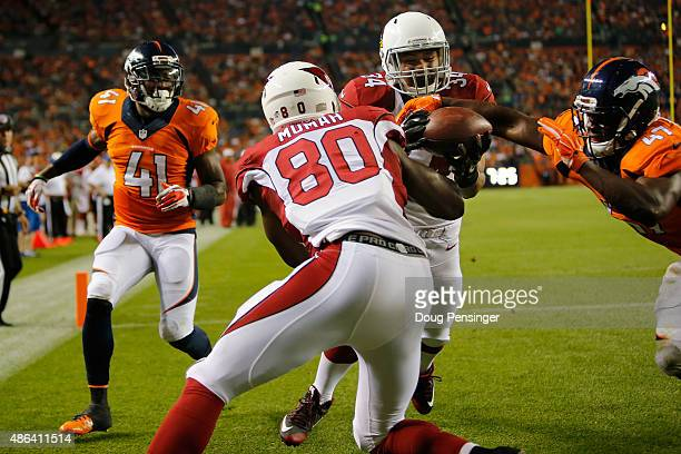 Paul Lasike of the Arizona Cardinals comes up with the ball for a touchdown reception between teammate Ifeanyi Momah of the Arizona Cardinals and...