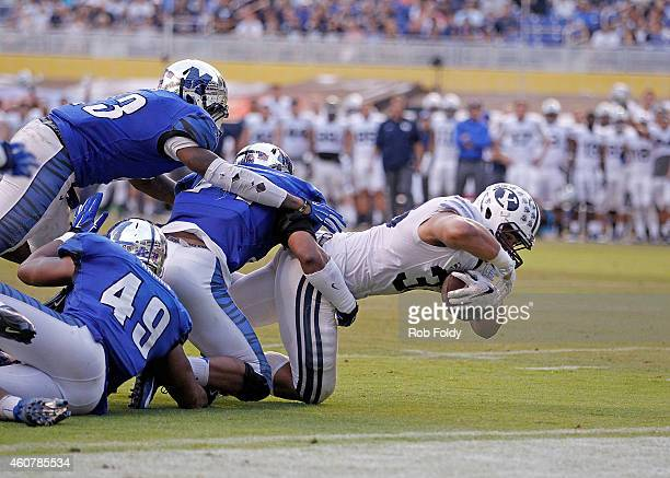 Paul Lasike of the Brigham Young Cougars reaches to score a touchdown during the second half of the game against the Memphis Tigers at Marlins Park...