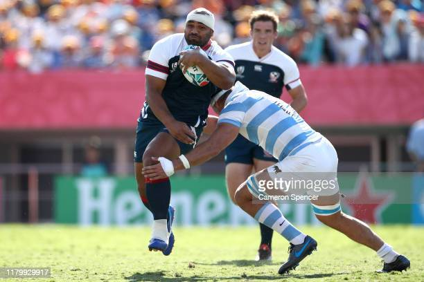 Paul Lasike of the United States is tackled during the Rugby World Cup 2019 Group C game between Argentina and USA at Kumagaya Rugby Stadium on...