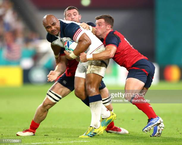 Paul Lasike of USA is tackled by George Ford and Mark Wilson of England during the Rugby World Cup 2019 Group C game between England and USA at Kobe...