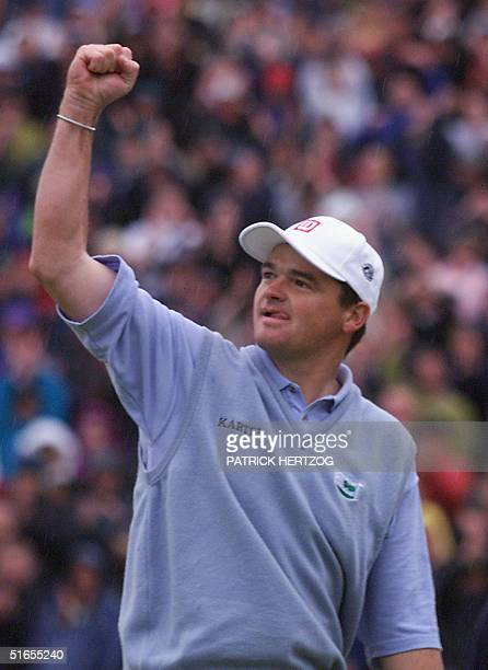 Paul Lawrie of Scotland celebrates his win of the128th British Open Championship at Carnoustie Sunday 18 July 1999 Lawrie won in a threeway playoff...