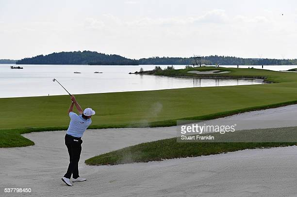 Paul Lawrie of Scotland hits out of the sand on the 15th hole during the second round on day two of the Nordea Masters at Bro Hof Slott Golf Club on...