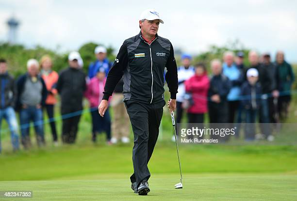 Paul Lawrie of Scotland looks for the line of a putt on the 5th green during the first day of the Saltire Energy Paul Lawrie Matchplay at Murcar...
