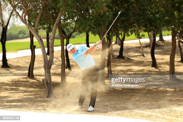Paul Lawrie of Scotland plays a shot on the 12th hole during round one of the Abu Dhabi HSBC Golf Championship at Abu Dhabi Golf Club on January 18...