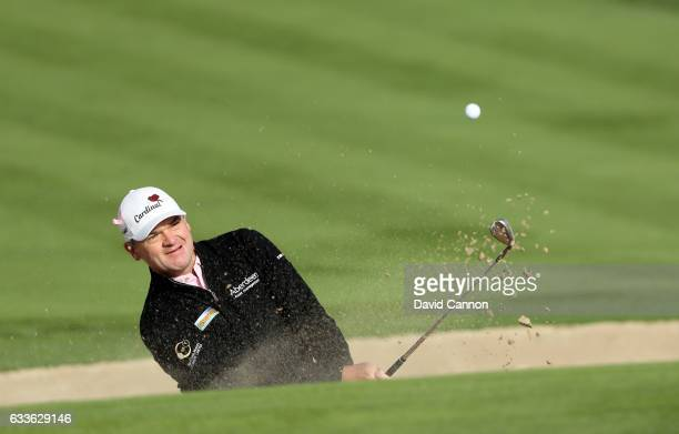 Paul Lawrie of Scotland plays his third shot on the third hole during the second round of the 2017 Omega Dubai Desert Classic on the Majlis Course at...