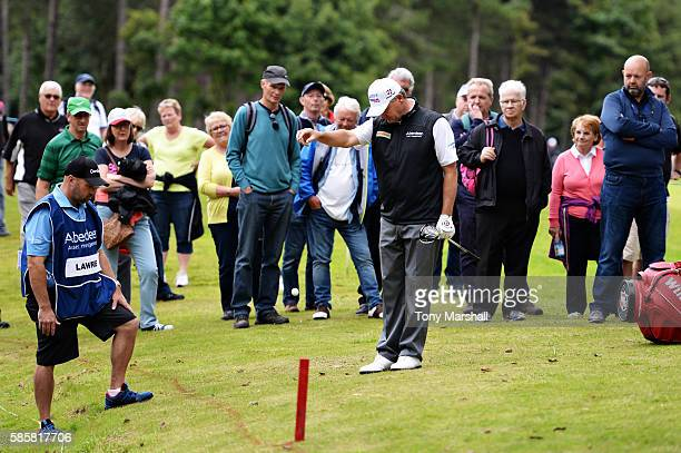 Paul Lawrie of Scotland takes a drop after going in the lake on hole 9 on day one of the Aberdeen Asset Management Paul Lawrie Matchplay at...