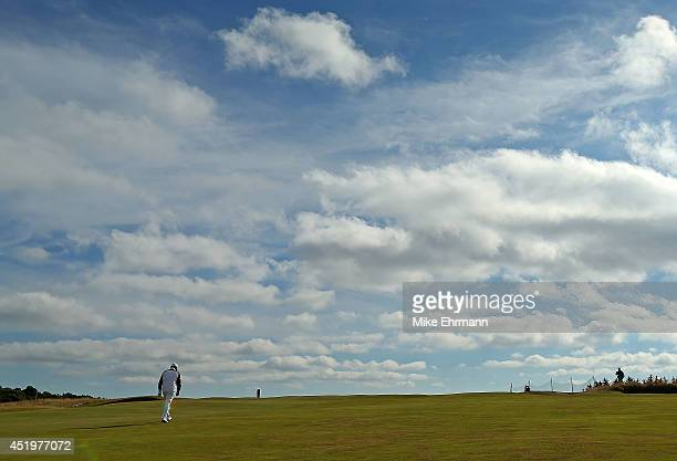 Paul Lawrie of Scotland walks up the 18th hole during the first round of the 2014 Aberdeen Asset Management Scottish Open at Royal Aberdeen Golf Club...