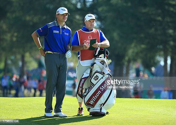 Paul Lawrie of Scotland with his caddy Dave Kenny during the third round of the Omega European Masters at the CranssurSierre Golf Club on September 7...
