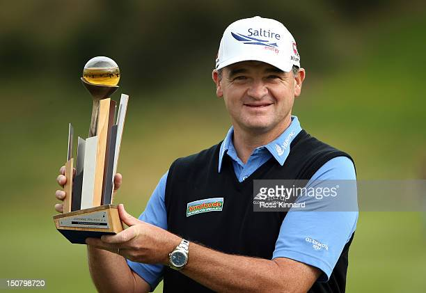 Paul Lawrie of Scotland with the winners trophy during the final round of the Johnnie Walker Championship on the PGA Centenary Course at Gleneagles...