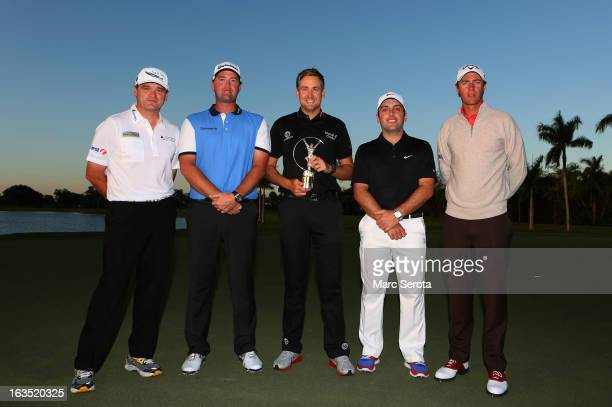 Paul Lawrie Peter Hanson Ian Poulter Francesco Molinari and Nicolas Colsaerts members of the victorious 2012 European Ryder Cup team pose with the...