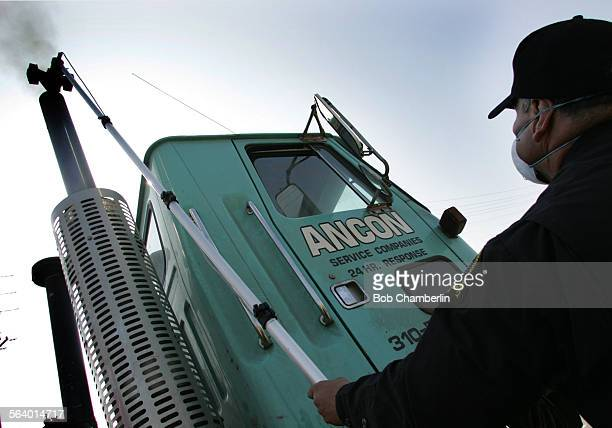 Paul Leon inserted Smog Check device into the smoke stack of the diesel truck to measure emissions as California Air Resources Board enforcement team...