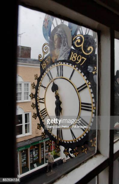 Paul Lester the Honorary Town Engineer for WottonunderEdge in Gloucestershire checks the Tolsey Clock from outside the building Mr Lester has...