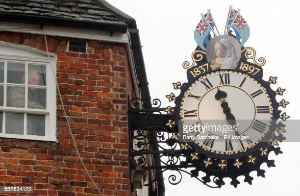 Paul Lester the Honorary Town Engineer for WottonunderEdge in Gloucestershire adjusts the time of the Tolsey Clock from inside the building Mr Lester...