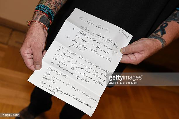 Paul Levey one of the survivors of child abuse by Catholic clergy in Australia holds a letter addressed to the Pope Francis with the request to a...