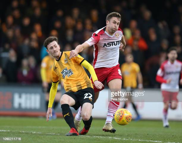 Paul Lewis of Cambridge United plays the ball under pressure from Joel Byrom of Stevenage during the Sky Bet League Two match between Cambridge...