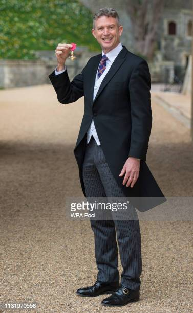 Paul Lindley with his OBE medal awarded by Queen Elizabeth II at an investiture ceremony at Windsor Castle on March 22 2019 in Windsor England