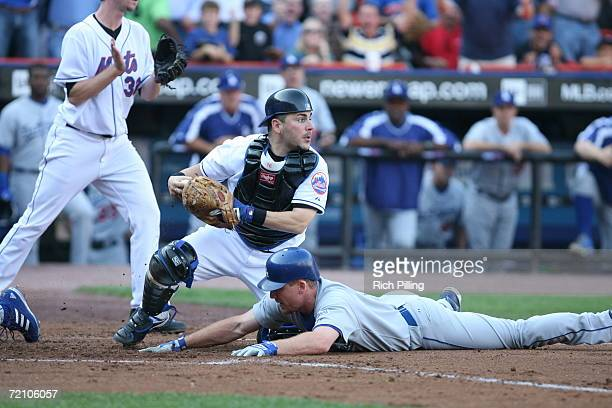 Paul LoDuca of the New York Mets tagging out J D Drew of the Los Angeles Dodgers during the National League Division Series game against the Los...