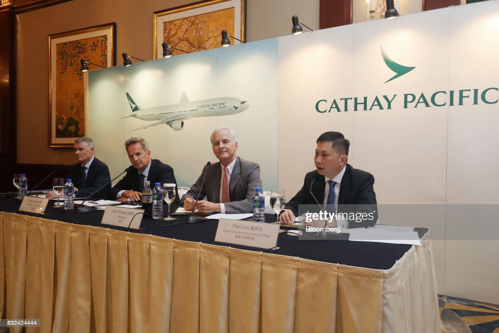 Paul Loo, chief customer and commercial officer of Cathay Pacific Airways Ltd., from right, speaks as John Slosar, chairman, and Rupert Hogg, chief executive officer, look on during a news conference in Hong Kong, China, on Wednesday, Aug. 16, 2017. Cathay Pacific is slipping in its efforts to get passengers to pay more for its premium services in a test for new Chief Executive OfficerRupert Hoggas the company reported back-to-back losses. Photographer: Paul Yeung/Bloomberg via Getty Images