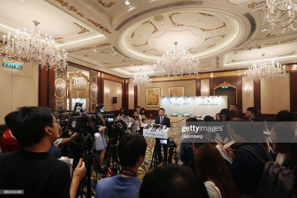 Paul Loo, chief customer and commercial officer of Cathay Pacific Airways Ltd., center, speaks to members of the media following a news conference in Hong Kong, China, on Wednesday, Aug. 16, 2017. Cathay Pacific is slipping in its efforts to get passengers to pay more for its premium services in a test for new Chief Executive Officer Rupert Hogg as the company reported back-to-back losses. Photographer: Paul Yeung/Bloomberg via Getty Images