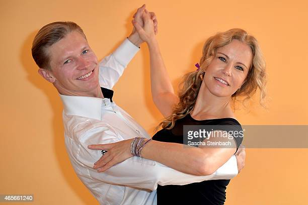 Paul Lorenz and Katja Burkard pose at a photo call for the television competition 'Let's Dance' on March 9 2015 in Cologne Germany On March 13th the...