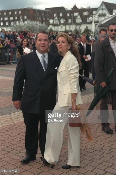 Paul Loup Sulitzer and his wife arrive at the projection of 'Saving Private Ryan'