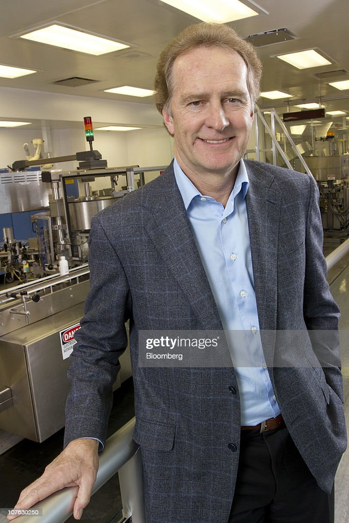 Paul Lucas, president and chief executive officer of GlaxoSmithKline Canada Inc., poses for a photograph in front of the production line at the company's Canadian headquarters in Mississauga, Ontario, Canada, on Monday, Dec. 13, 2010. Lucas has been head of GlaxoSmithKline's Canadian operations since 2000. Photographer: Norm Betts/Bloomberg via Getty Images