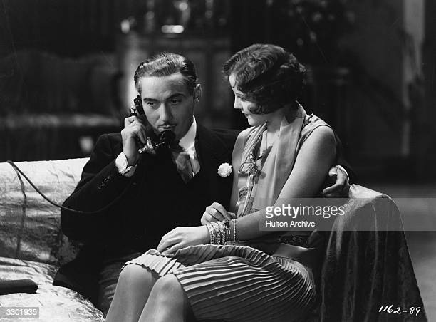 Paul Lukas and Nancy Carroll formerly Ann La Hiff the leading lady are in romantic mood in a scene from 'Shopworn Angel' directed by Richard Wallace...