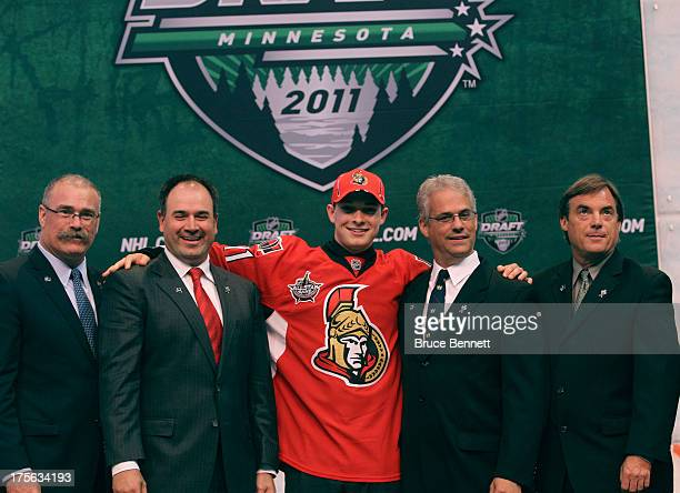 Paul MacLean Pierre Dorion Matt Puempel Greg Royce and George Fargher stand on stage after Puempel is chosen as the 24th overall pick by the Ottawa...