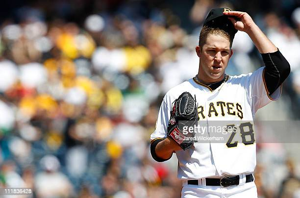 Paul Maholm of the Pittsburgh Pirates takes a moment inbetween pitches against the Colorado Rockies during the Opening Day game on April 7 2011 at...