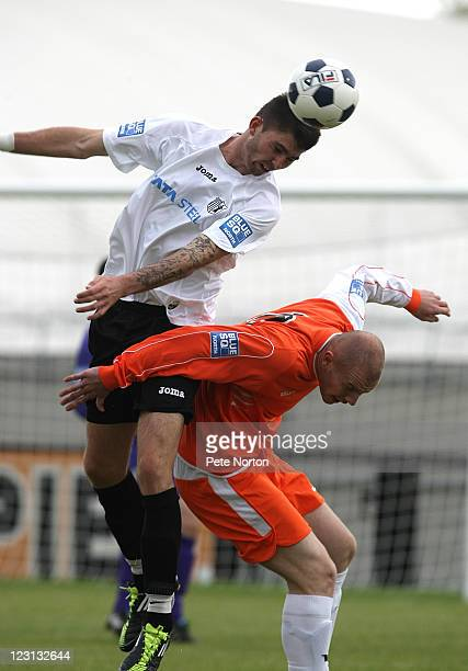 Paul Malone of Corby Town heads the ball under pressure from Jason Bradley of Eastwood Town during the Blue Sq Conference North match between Corby...