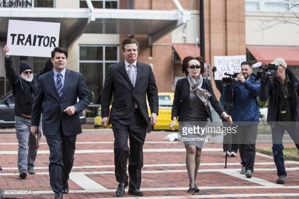 Paul Manafort former campaign manager for Donald Trump center arrives as a man holds a sign reading 'Traitor' outside the District Courthouse in...