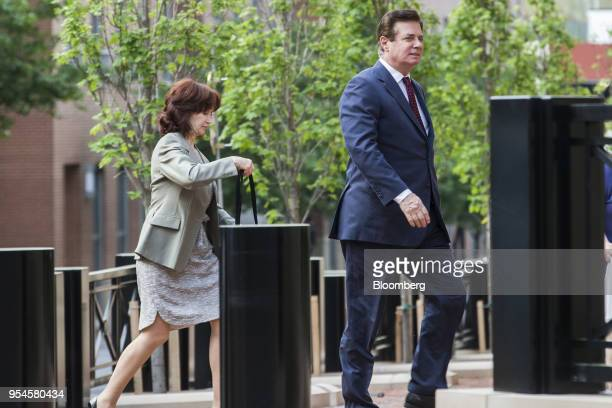 Paul Manafort former campaign manager for Donald Trump right and wife Kathleen Manafort arrive for a motion hearing at the District Courthouse in...