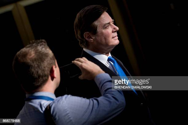 Paul Manafort former campaign manager for US President Donald Trump leaves the E Barrett Prettyman United States Court House after being charged...