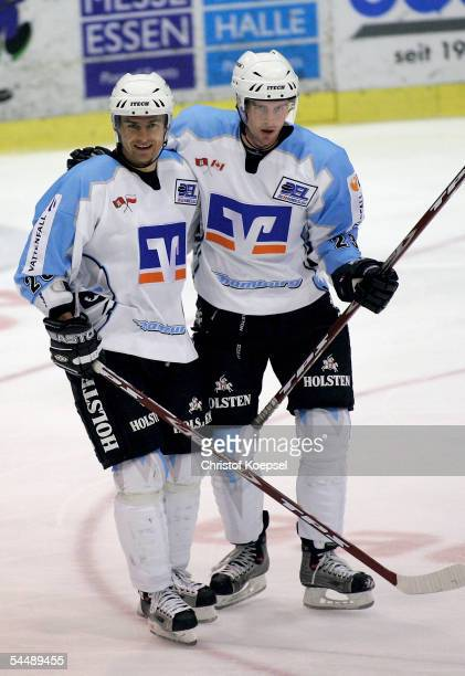 Paul Manning celebrates his first goal with Jacek Plachta of the Freezers during the Ice Hockey German Cup match between ESC Moskitos Essen and...