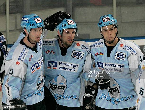 Paul Manning, Francois Fortier and Florian Schnitzer of Hamburg celebrate their goal against Nuremberg during the DEL match between Sinupret Ice...