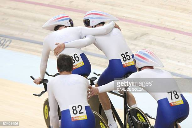 Paul Manning Geraint Thomas Bradley Wiggins and Ed Clancy members of the track cycling team of Great Britain celebrate after winning the gold medal...