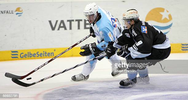 Paul Manning of Hamburg tussels with Aab Vitalij of Iserlohn during the DEL match between Hamburg Freezers and Iserlohn Roosters at the Color Line...