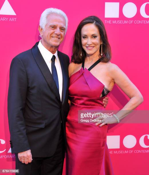Paul Marciano and Lilly Tartikoff Karatz arrive at the MOCA Gala 2017 at The Geffen Contemporary at MOCA on April 29 2017 in Los Angeles California